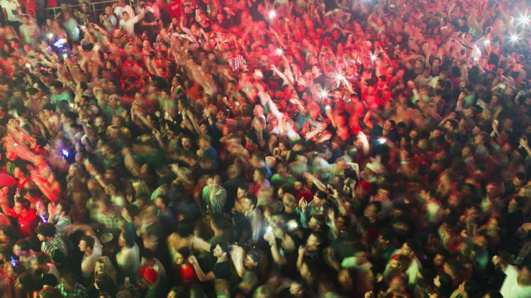 Members of the audience react as rapper Snoop Dogg performs in a discotheque during spring break season in Cancun