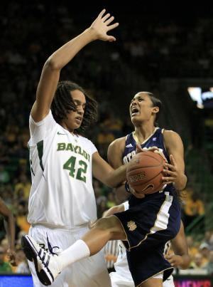 Baylor center Brittney Griner (42) blocks a drive to the basket by Notre Dame guard Skylar Diggins, right, in the first half of an NCAA college basketball game in the women's Preseason NIT on Sunday, Nov. 20, 2011, in Waco, Texas. (AP Photo/Tony Gutierrez)