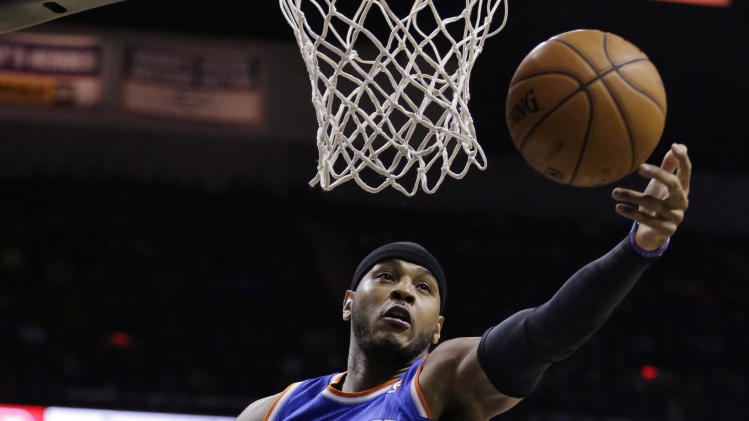 New York Knicks' Carmelo Anthon reaches for a rebound against the San Antonio Spurs during the first half on an NBA basketball game, Thursday, Jan. 2, 2014, in San Antonio. (AP Photo/Eric Gay)