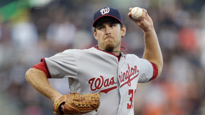 Washington Nationals starting pitcher Zach Duke throws to the San Francisco Giants during the first inning of a baseball game on Monday, May 20, 2013 in San Francisco. (AP Photo/Marcio Jose Sanchez)
