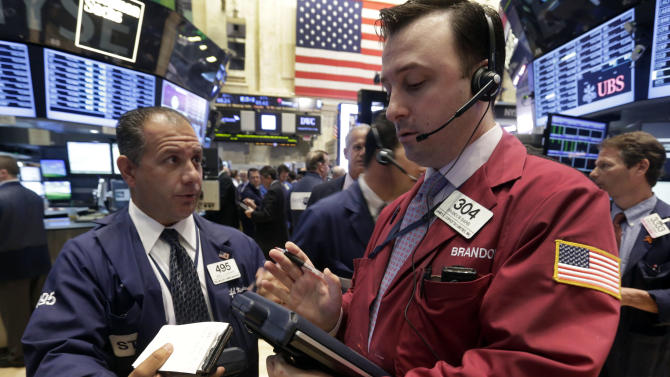 In this Monday, June 10, 2013 photo, traders Joel Lucchese, left, and Brandon Barb confer on the floor of the New York Stock Exchange. Global stock markets endured sharp losses Thursday June 13, 2013 as gyrations on the Tokyo market, the Asian region's biggest, continued _ fueled by worries about a surging yen and monetary policies in the U.S. (AP Photo/Richard Drew)