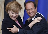 "<p>France's President Francois Hollande embraces German Chancellor Angela Merkel during a meeting in Reims on July 8. The leaders of Germany and France have thrown their political support behind ECB chief Mario Draghi's vow to do ""everything"" to protect the eurozone, after another brutal week of market turmoil.</p>"