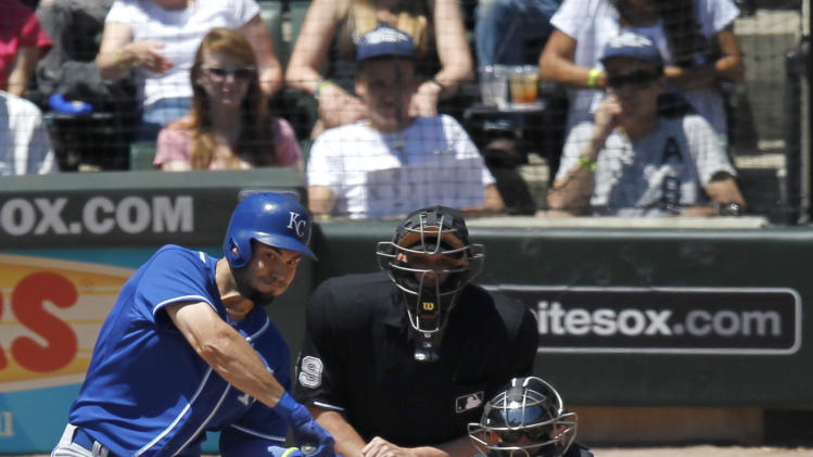 Kansas City Royals' Eric Hosmer hits a sacrifice fly off Chicago White Sox's starting pitcher Jose Quintana, scoring Lorenzo Cain, during the first inning of a baseball game Wednesday, July 23, 2014, in Chicago. (AP Photo/Stacy Thacker)