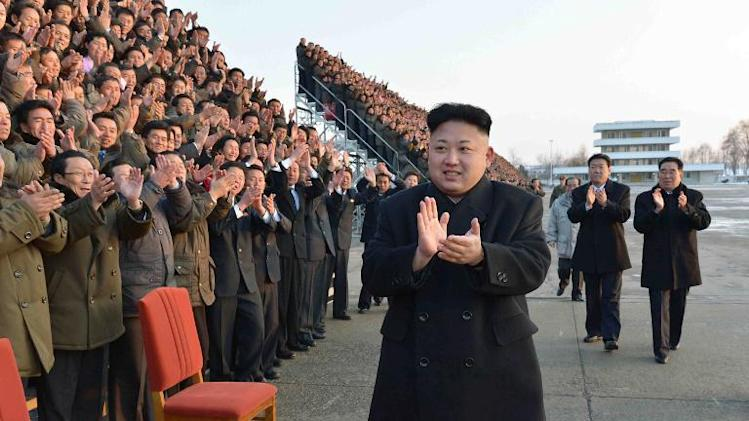 KCNA handout photo provided on February 11, 2014 shows North Korean leader Kim Jong-Un (C) in an undisclosed location in North Korea