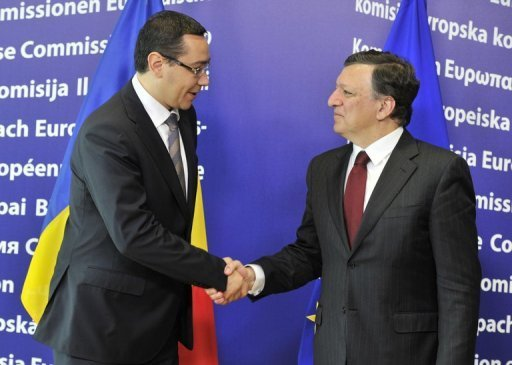 <p>European Commission President Jose Manuel Barroso (R) shakes hands with Romanian Prime Minister Victor Ponta (L) before their working session at the EU headquarters in Brussels on July 12. The EU executive delivered a harsh verdict on Romania's respect for democratic values and threatened tighter policing to ensure respect for the rule of law, in a report seen by AFP on Tuesday.</p>
