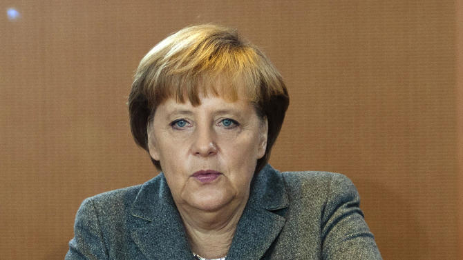 German Chancellor Angela Merkel arrives at the weekly cabinet meeting at the chancellery in Berlin, Wednesday, Nov. 9, 2011. An independent panel of economists that advises the German government is forecasting that growth in Europe's biggest economy will slip below 1 percent next year. (AP Photo/Markus Schreiber)