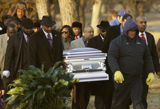 The remains of Hadiya Pendleton are taken to her final resting place at the Cedar Park Cemetery Saturday, Feb. 9, 2013, in Calumet Park, Ill. Pendleton was killed on Jan. 29, when a gunman opened fire on her and some friends seeking shelter in a park from the rain about a mile from President Obama&#39;s Chicago home. First lady Michelle Obama attended the funeral with Senior White House Adviser Valerie Jarrett and Secretary of Education Arne Duncan. (AP Photo/Charles Rex Arbogast)