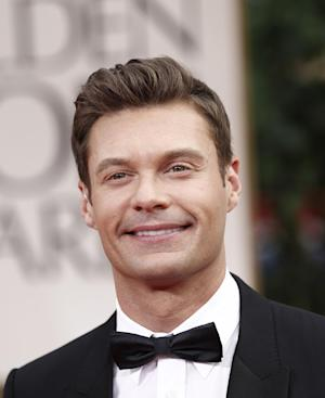 "File - In a Jan. 15, 2012 file photo, Ryan Seacrest arrives on the red carpet to the 69th Annual Golden Globe Awards, in Los Angeles. Seacrest announced on Wednesday's April 4, 2012 ""Today"" show that he'll be taking part in NBC's coverage of the Summer Olympics.  (AP Photo/Matt Sayles, File)"