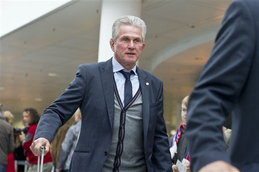 Munichs  coach Jupp Heynckes   on his way to board a plane to London at the  airport  in Munich, Germany Friday May 24, 2013. Bayern  Munich will play against  German rival Borussia Dortmund in a UEFA