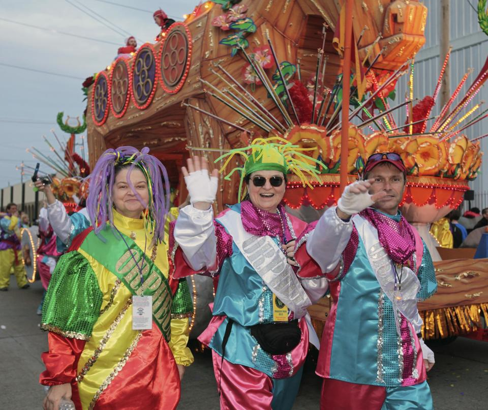 Riders in the Mardi Gras parade make their way to their float in the staging area of the parade in New Orleans, Monday, Feb. 20, 2012. (AP Photo/Bill Haber)