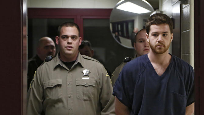 FILE - In this Thursday, Jan. 23, 2014, file photo, Cody Cousins, right, walks down the hall inside the Tippecanoe County Jail in Lafayette, Ind., on the way to his initial hearing on charges of murder in the shooting and stabbing death of engineering student Andrew Boldt on the campus of Purdue University.  Cousins pleaded guilty to murder last month for the attack that killed Boldt. His attorney says he'll ask the judge to rule Cousins guilty but mentally ill. Cousins' sentencing is set for Friday, Sept. 19, 2014. (AP Photo/Journal & Courier, John Terhune, Pool, File)