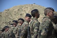 French soldiers, pictured during a transition ceremony with Afghan troops at Surobi base, in April. France&#39;s defence minister arrived in Afghanistan Sunday, the day after an attack that killed four French soldiers and an announcement that France would begin withdrawing troops in July
