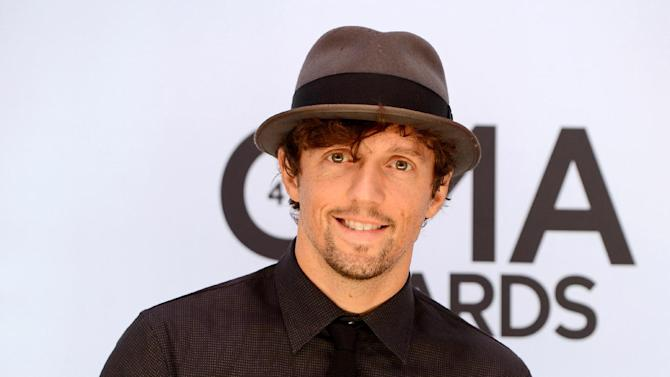 "FILE - This Nov. 6, 2013 file photo shows singer Jason Mraz at the 47th annual CMA Awards at Bridgestone Arena in Nashville, Tenn. Mraz announced Wednesday, July 16, 2014, he would tour the five boroughs of New York in September. Mraz said at a conference at the Empire State Building that he would kick it off Sept. 17 at the Brooklyn Center for Performing Arts at Brooklyn College. ""The Five Boroughs Tour"" will wrap with two nights at Manhattan's Radio City Music Hall on Sept. 22 and 23. Tickets for all shows go on sale July 21. (Photo by Evan Agostini/Invision/AP, File)"