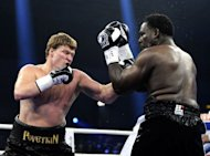 Russia's Alexander Povetkin punches American Hasim Rahman during their WBA title fight in Hamburg, northern Germany. Povetkin retained his WBA world heavyweight title on Saturday with a second-round stoppage of former world champion Rahman