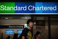 A branch of Standard Chartered bank in Hong Kong on August 1, 2012. New York&#39;s Department of Financial Services has threatened the bank with fines and possible suspension of its license to operate in the state, hub of the US financial industry, in the latest US move against foreign banks trading with Tehran