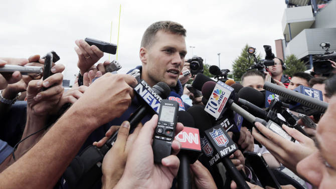 New England Patriots quarterback Tom Brady talks with reporters following NFL football practice in Foxborough, Mass., Thursday, July 25, 2013.(AP Photo/Charles Krupa)