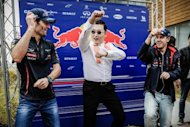 "K-Pop star Psy (C) performs the ""Gangnam style"" dance with Red Bull-Renault drivers Mark Webber (L) and Sebastian Vettel in Yeongam on October 14. For a fourth straight week, the South Korean rapper's ""Gangnam Style"" remained at number two on Billboard's authoritative Hot 100 pop music chart, released Wednesday"