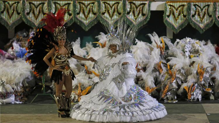 Durraes and her daughter prepare for a parade in the Mancha Verde samba school during a carnival in Sao Paulo