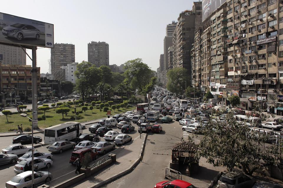 In this Monday, April 30, 2012 photo, Egyptian vehicles jam the streets in Cairo, Egypt. The streets and sidewalks of Cairo have always been rather chaotic. But they've only gotten worse in the political turmoil as Egypt stumbles towards a new system following the fall of President Hosni Mubarak. (AP Photo/Nasser Nasser)
