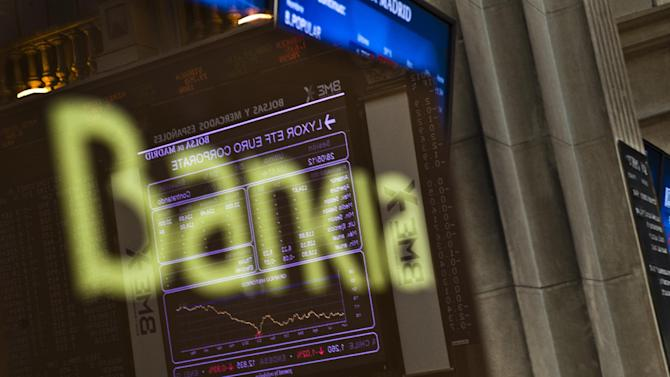 The Stock Exchange main display is reflected on a Bankia sign in Madrid, Monday, May 28, 2012.  Shares in Spanish bank Bankia, one of the banks hardest hit by Spain's real estate collapse over the past four years, fell 28 per cent on opening in Madrid on Monday, the bank's first day back on the stock exchange following its announcement Friday that it would need Euro 19 billion ($23.8 billion) bailout to bolster its defenses.(AP Photo/Daniel Ochoa de Olza)