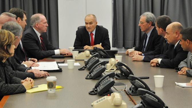 "FILE - In a Sept. 26, 2009, file photo released by the New York City Police Department,  Police Commissioner Raymond Kelly, center, briefs New York police officials and John O. Brennan, center left, assistant to the president for Homeland Security and Counter-terrorism, and Deputy New York Police Commissioner of Intelligence David Cohen, center right, on events surrounding the alleged plot to bomb New York commuter trains, at Police Headquarters in New York. Working with the CIA, the New York Police Department maintained a list of ""ancestries of interest"" and dispatched undercover officers to monitor Muslim businesses and social groups, according to new documents that offer a rare glimpse inside an intelligence program the NYPD insists doesn't exist.  (AP Photo/NYPD, File)"