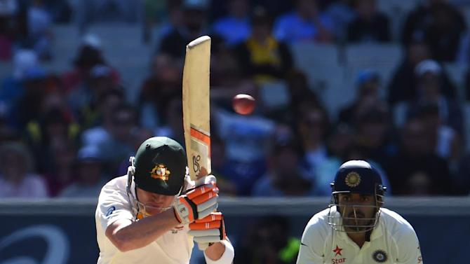 Australia's batsman Brad Haddin (L) avoids a bouncer from India's paceman Umesh Yadav on the first day of their 3rd Test, at the Melbourne Cricket Ground (MCG), on December 26, 2014