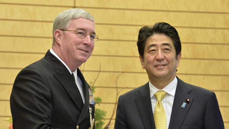 Vice Admiral John Miller, commander of U.S. Naval Forces Central Command and 5th Fleet, shakes hands with Japan's Prime Minister Shinzo Abe in Tokyo