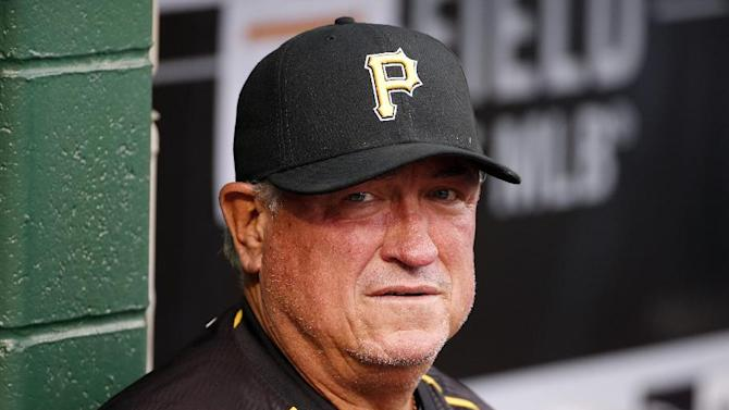 Pittsburgh Pirates' Clint Hurdle stands in the dugout before a baseball game between the Pittsburgh Pirates and the Milwaukee Brewers in Pittsburgh, Saturday, April 18, 2015. (AP Photo/Gene J. Puskar)