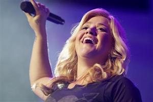 Kelly Clarkson performs at the annual shareholders meeting for Walmart in Fayetteville, Arkansas