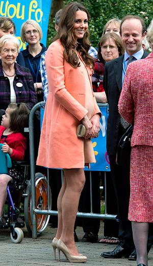 Kate Middleton Wears Bump-Hugging Peach Dress During Hospice Visit on Anniversary