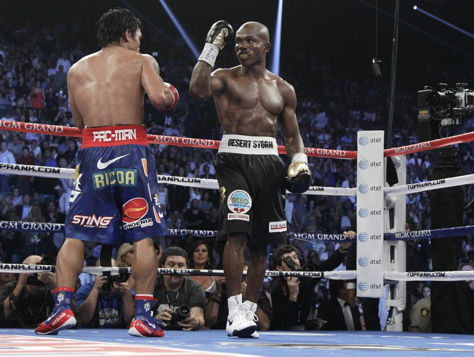 Timothy Bradley, from Palm Springs, Calif., right, and Manny Pacquiao, from the Philippines, return their corners at the end of their WBO world welterweight title fight Saturday, June 9, 2012, in Las Vegas. Bradley won the fight by split decision. (AP Photo/Julie Jacobson)