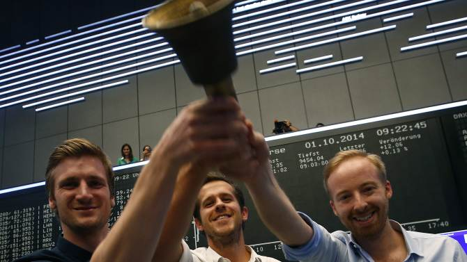Zalando management board members Schneider Gentz and Ritter ring the bell during the initial public offering of the company at the Frankfurt stock exchange