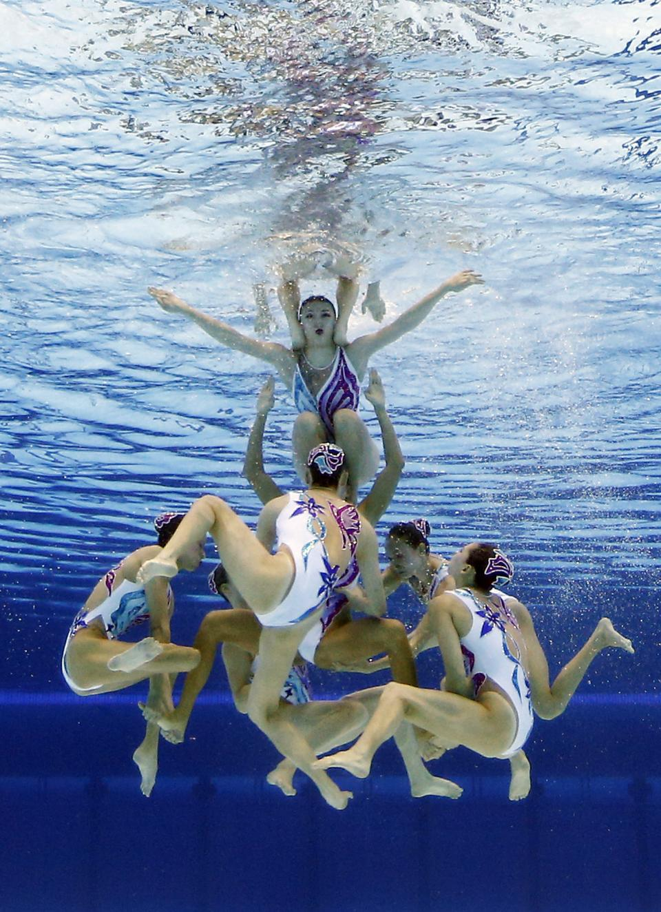 The team from China competes during the synchronized swimming team free routine final at the Aquatics Centre in the Olympic Park during the 2012 Summer Olympics in London, Friday, Aug. 10, 2012. China took the silver medal in the event. (AP Photo/Mark J. Terrill)
