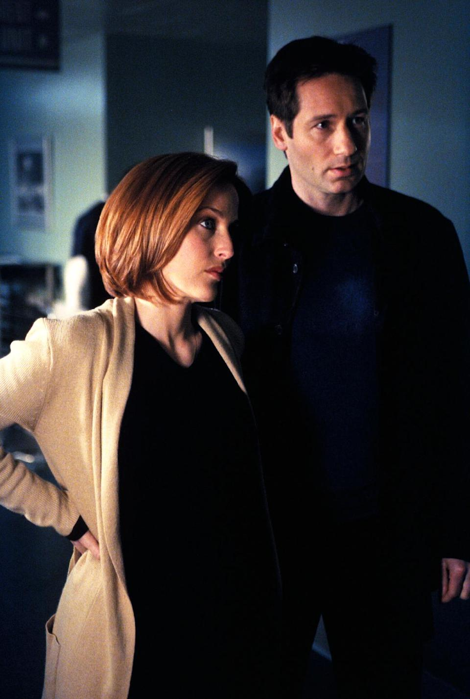 "This publicity photo courtesy of Twentieth Century Fox Television shows Gillian Anderson, left, as Special Agent Dana Scully, and David Duchovny as Special Agent Fox Mulder, in a scene from the TV series, ""The X-Files."" (AP Photo/Copyright Twentieth Century Fox Film Corporation)"