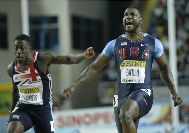 United States' Justin Gatlin celebrates winning the Men's 60m final during the World Indoor Athletics Championships in Istanbul, Turkey, Saturday, March 10, 2012. Left is Britain's Dwain Chambers. (AP
