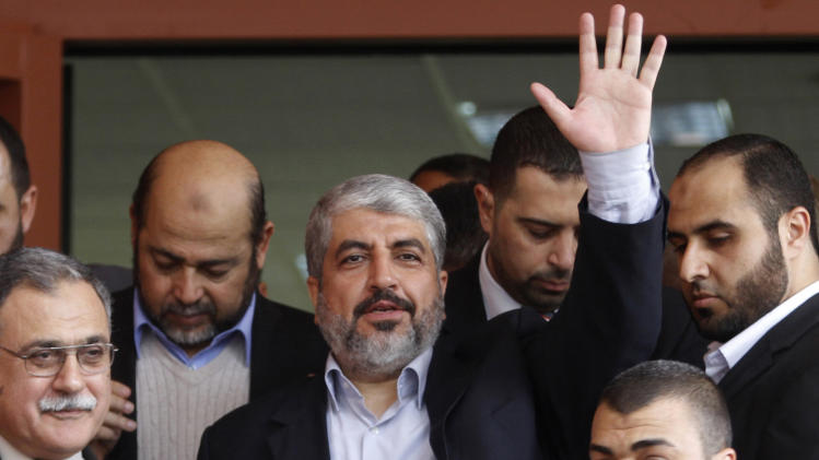 File - In this Dec. 9, 2012 file photo, Hamas leader Khaled Mashaal waves during his visit to the Islamic University in Gaza City. Hamas chief Khaled Mashaal has set an ambitious agenda for his new term, seeking to transform his once isolated Islamic militant movement into a widely recognized political force, without making concessions toward Israel needed for international acceptance. (AP Photo/Hatem Moussa, File)