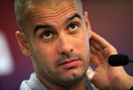 "Then Barcelona coach Pep Guardiola gives a press conference at the ""Sports Center FC Barcelona Joan Gamper"" near Barcelona on August 13, 2011. Guardiola will take over as Bayern Munich head coach for the 2013/14 season, the Bundesliga giants confirmed Wednesday, with the Spaniard offered a contract until 2016"