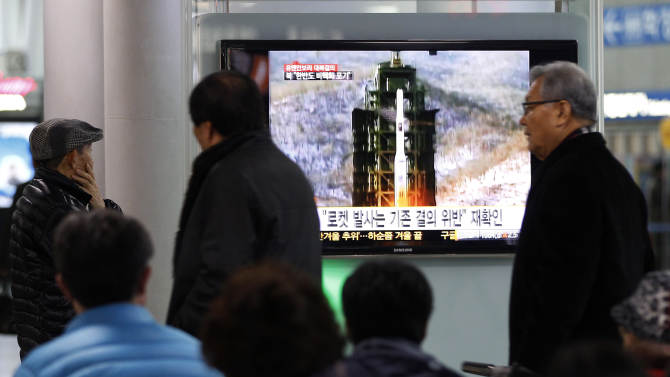 People watch TV showing Dec. 12, 2012 file footage of the Unha rocket launching in North Korea, at Seoul Railway Station in Seoul, South Korea, Wednesday, Jan. 23, 2013.  North Korea swiftly lashed out against the U.N. Security Council's condemnation of its December launch of a long-range rocket, saying Wednesday that it will strengthen its military defenses - including its nuclear weaponry - in response.(AP Photo/Ahn Young-joon)