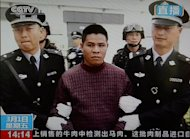 This frame grab taken from Chinese television CCTV on March 1, 2013, shows convicted murderer Zha Xika of Laos being led from his prison cell as he is transferred for execution in Yunnan Province