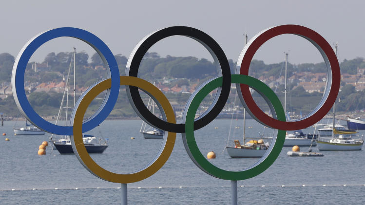 The olympic rings are seen in the Weymouth and Portland venue at the London 2012 Summer Olympics, Thursday, Aug. 9, 2012. The men's 470 medals race was postponed Thursday due to lack of wind on the nicest day of the Olympic sailing regatta. (AP Photo/Bernat Armangue)