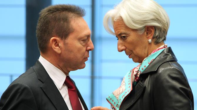 Greek Finance Minister Yannis Stournaras , left, talks with International Monetary Fund managing director Christine Lagarde, during the Eurogroup meeting, in Luxembourg, Monday Oct. 8, 2012. Finance ministers from the nations sharing the euro currency assess the latest developments in the financial crisis. (AP Photo/Yves Logghe)