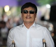 Chen Guangcheng, the blind Chinese activist whose flight to the US embassy in Beijing sparked a major diplomatic incident, pictured in May 2012, said Thursday that sanctions against his family are waning