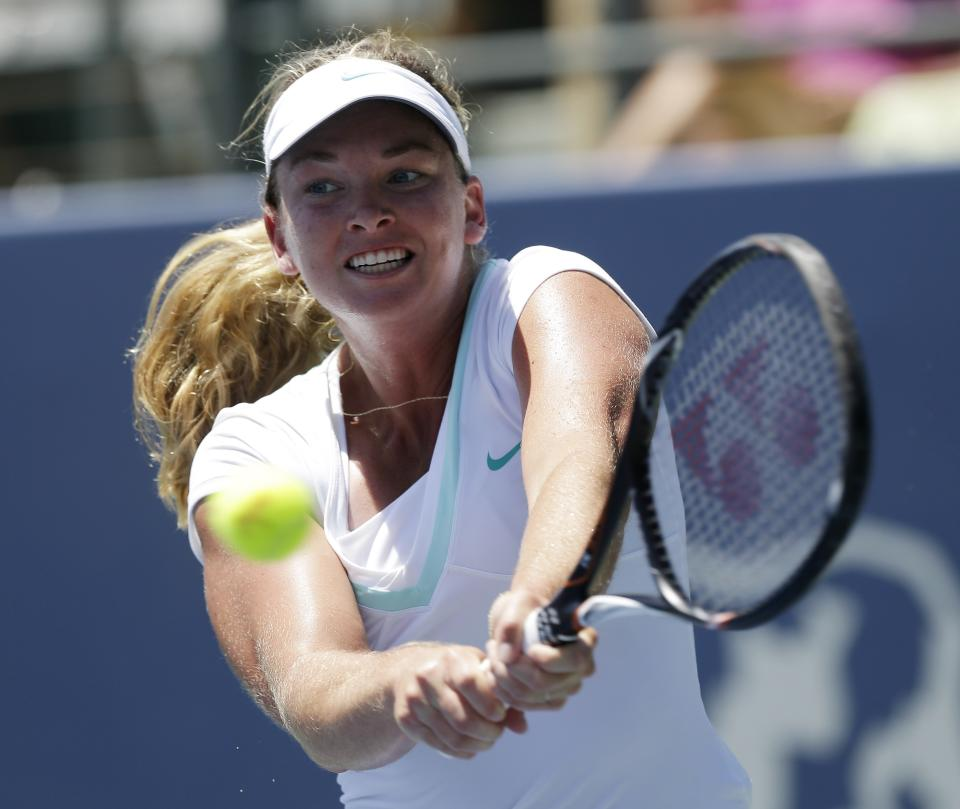 Coco Vandeweghe, of the United States, returns to Serena Williams, of the United States, during the final of the Bank of the West tennis tournament on Sunday, July 15, 2012, in Stanford, Calif. (AP Photo/Marcio Jose Sanchez)