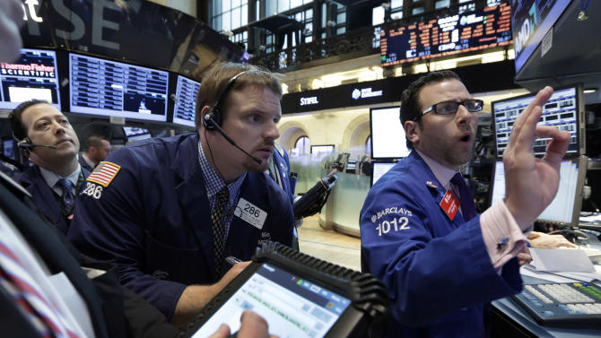 Specialist Michael Pistillo, right, works on the floor of the New York Stock Exchange Wednesday, April 24, 2013. Stock indexes are little changed in early trading on Wall Street following mixed earnings results from Apple, Ford, Boeing and other major U.S. companies. (AP Photo/Richard Drew)