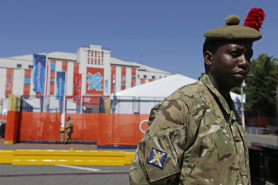 A British soldier stands guard outside of Earl's Court, the site of the Volleyball competition, at the 2012 Summer Olympics, Tuesday, July 24, 2012, in London. (AP Photo/Darron Cummings)