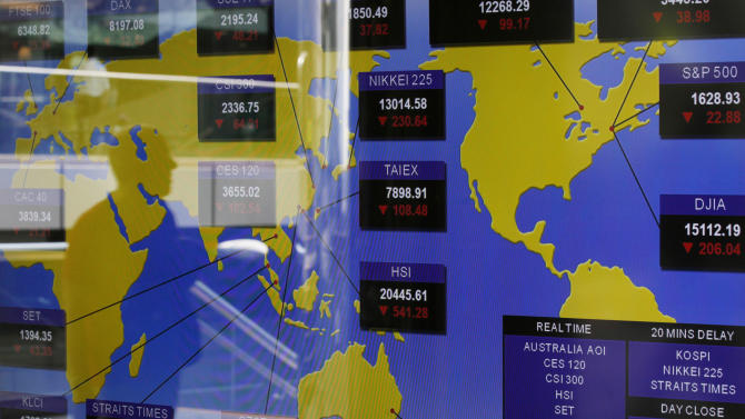 A TV screen shows the Asian stocks index at the Hong Kong Stock Exchange Thursday, June 20, 2013. Asian stock markets plummeted Thursday after the U.S. Federal Reserve said it could start scaling back its huge economic stimulus program later this year. (AP Photo/Kin Cheung)