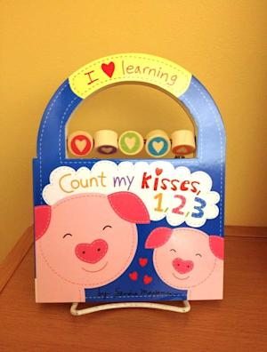 """This undated image made available by the U.S. Consumer Product Safety Commission on Friday, Sept. 13, 2013, shows the children's book titled """"Count my Kisses, 1, 2, 3."""" Hachette Book Group recalled the book because a metal rod holding small beads on the cover can detach and release small parts that present a choking hazard. (AP Photo/CPSC)"""
