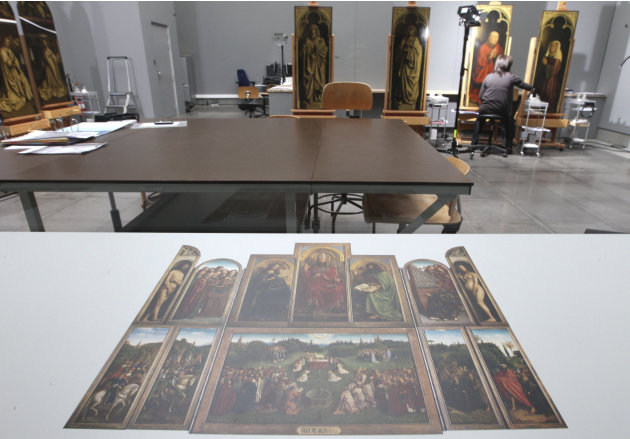 FILE - In this Oct. 11, 2012 file photo, a restorer inspects, also visible in the foreground, one of the 24 framed panels of the Altarpiece or Adoration of the Mystic Lamb, at the Fine Arts museum in