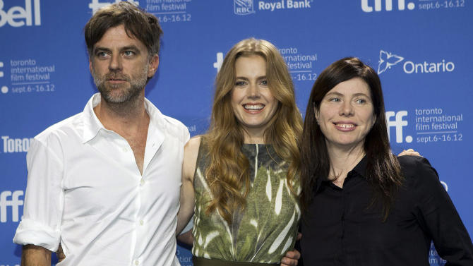 "FILE - In this Sept. 8, 2012 file photo, director Paul Thomas Anderson, left, poses with actress Amy Adams, center, and producer JoAnne Seller at a photo call before a press conference for their new movie ""The Master"" at the 2012 Toronto International Film Festival in Toronto. On Sunday, Dec. 9, 2012, the Los Angeles Film Critics Association announced their picks for movies of 2012.  The French old-age drama ""Amour"" was chosen as the year's best film.  The 1950s cult drama ""The Master"" earned three awards: best director for Paul Thomas Anderson, best actor for Joaquin Phoenix and supporting actress for Amy Adams.  ""The Master"" also was chosen as best-picture runner-up.  ""Amour"" star Emmanuelle Riva shared the best-actress honor in a tie with Jennifer Lawrence for the lost-soul romance ""Silver Linings Playbook."" Newcomer Dwight Henry was chosen as supporting actor for the low-budget critical darling ""Beasts of the Southern Wild.""  (AP Photo/The Canadian Press, Michelle Siu, File)"