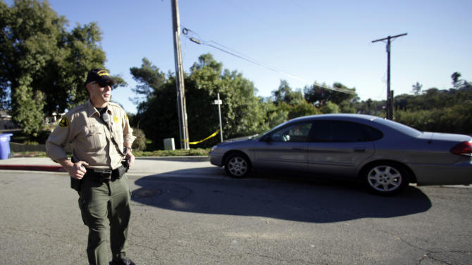 A San Diego County sheriff deputy blocks the road leading to a home in a hilly neighborhood of Escondido, Calif. where authorities recently found the largest supply of homemade explosives in a single location in United States history, Wednesday, Dec. 1, 2010. The home was rented and occupied by a George Djura Jakubec and is scheduled to be burned next week. (AP Photo/Lenny Ignelzi)
